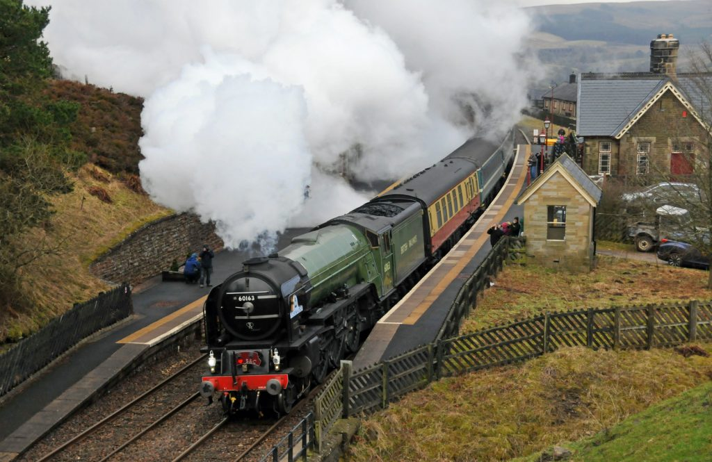 Tornado through Dent Station, captured by photographer Paul Baxter. There I am in blue, snapping the moment.